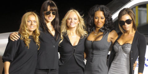 """The Spice Girls pose after naming a Virgin Atlantic Boeing 747 plane """"Spice One"""" in their honor at Los Angeles International Airport, 12 December 2007. From left are: Geri Halliwell, Melanie Chisholm, Emma Burton, Melanie Brown and Victoria Beckham. AFP PHOTO GABRIEL BOUYS (Photo credit should read GABRIEL BOUYS/AFP/Getty Images)"""